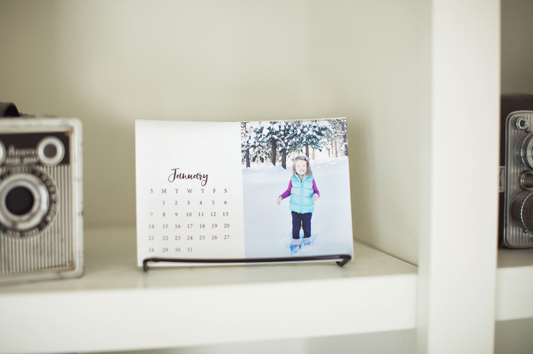 Check out this free download to make your own photo calendar in the Project Life App.  It's a super easy and inexpensive way to make a personalized gift!